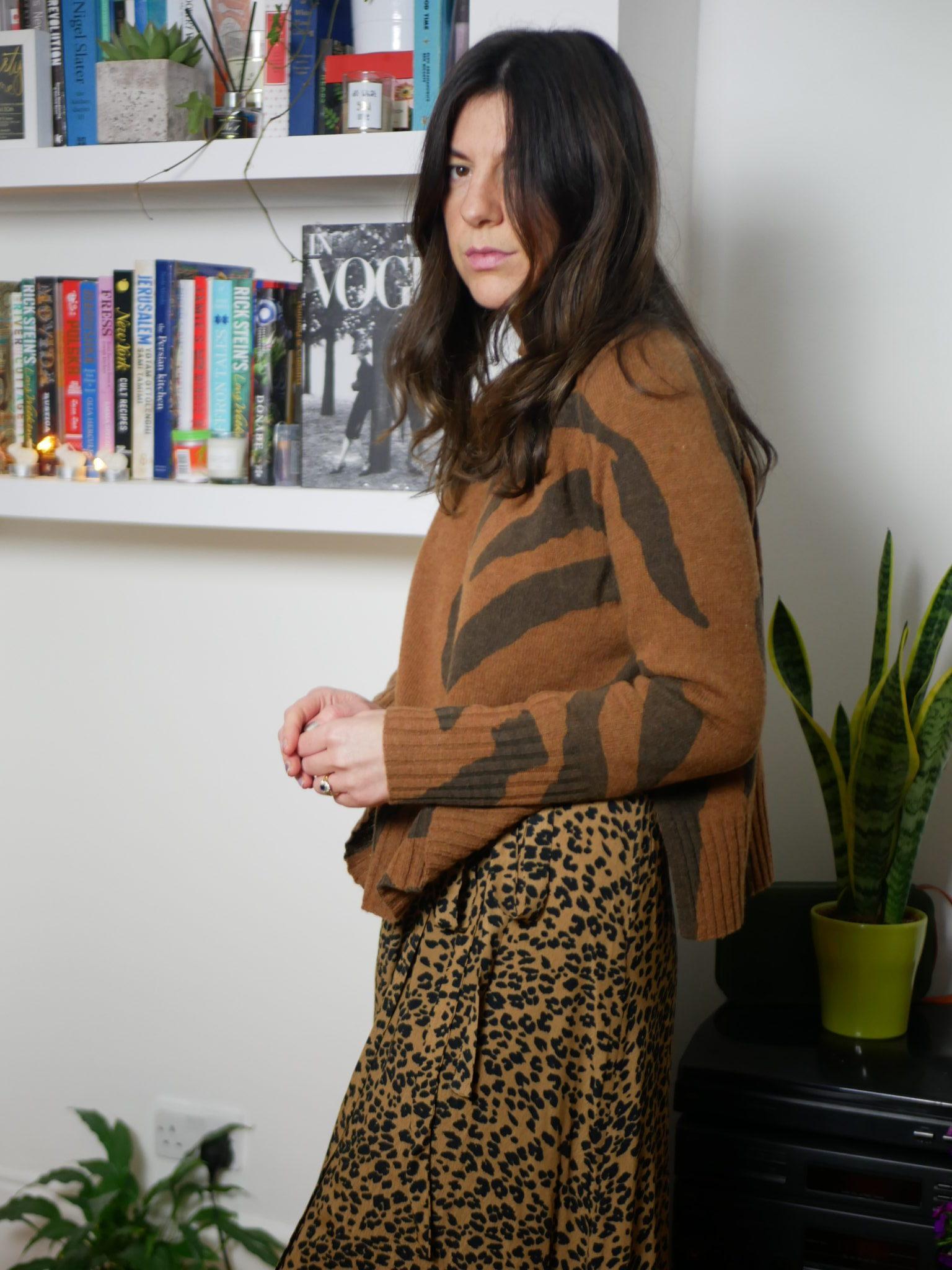 "<a href= ""https://www.endource.com/product/and-other-stories-leopard-print-wrap-dress/W-RcwUbg-wAB2FRl""><u>Dress: & Other Stories</a></u><br/><a href= ""https://www.endource.com/product/whistles-animal-funnel-neck-wool-knit/W63YsEbg-wABwXH4""><u>Jumper: Whistles</a></u>"